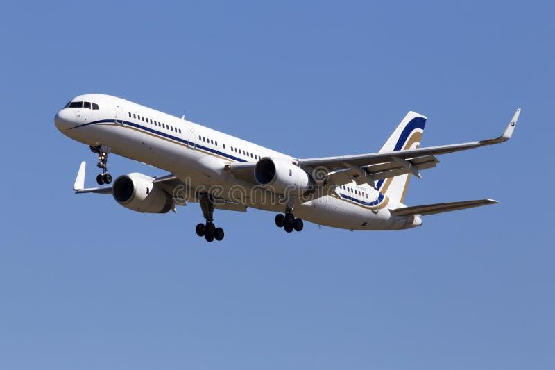 FlygBoeing 757-23NWL för SX-RFA GainJet flygplan på bakgrunden för blå himmel royaltyfri fotografi