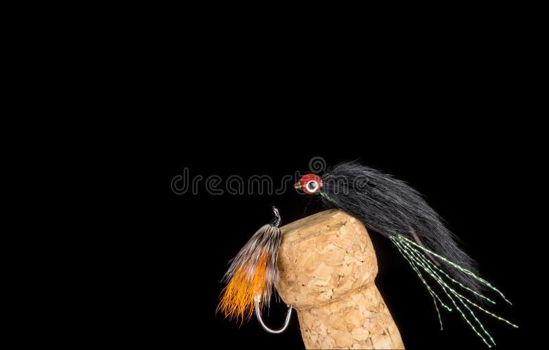 Flyger den färgrika handen bundet fiske visat på Champagne Cork 5 royaltyfria foton