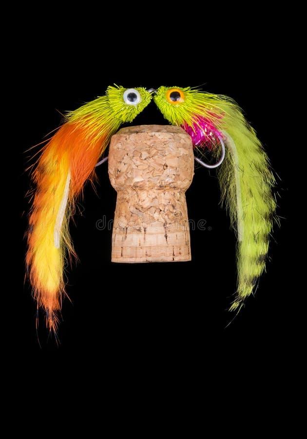 Flyger den färgrika handen bundet fiske visat på Champagne Cork 4 arkivfoto