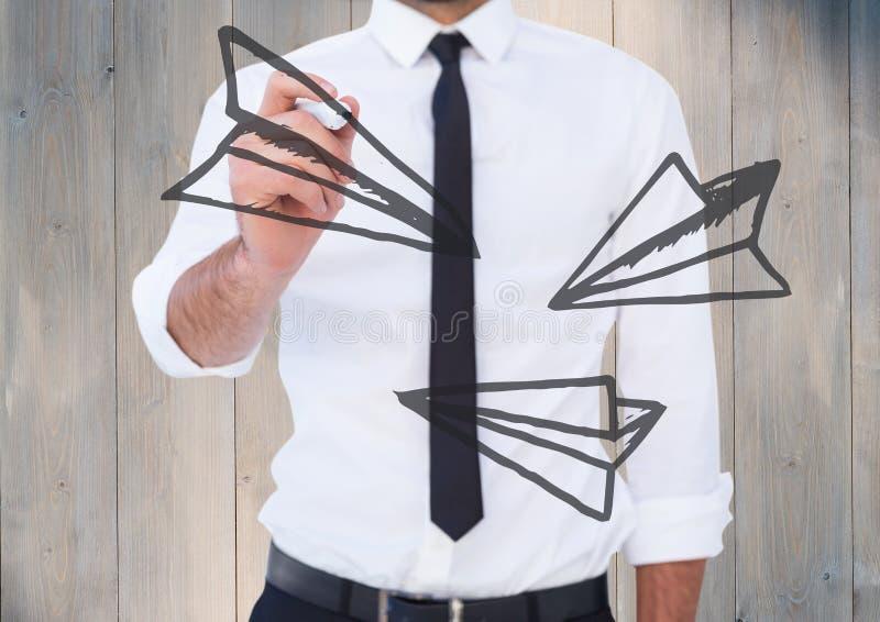 Flygplanet för handstil för avsnittet för affärsmannen klottrar det mitt- mot grå wood panel arkivbild