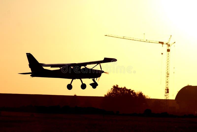 Flygplanskugga och crayn arkivbild