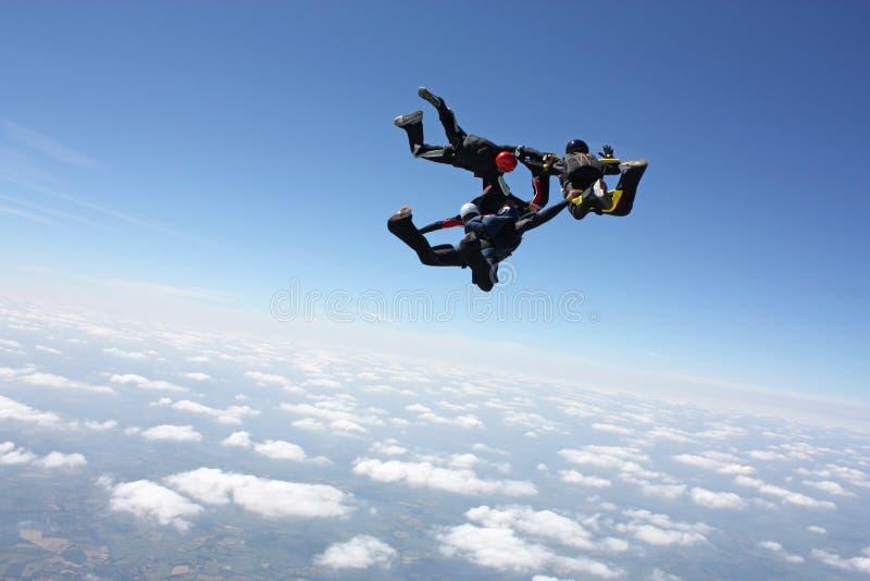 flygplanutgång fyra har skydivers arkivfoton