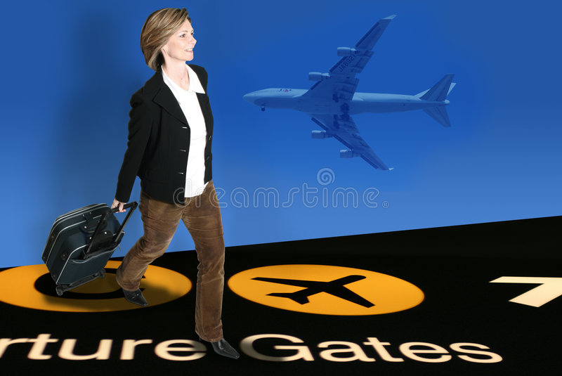 flygplatsaffärskvinna royaltyfri bild