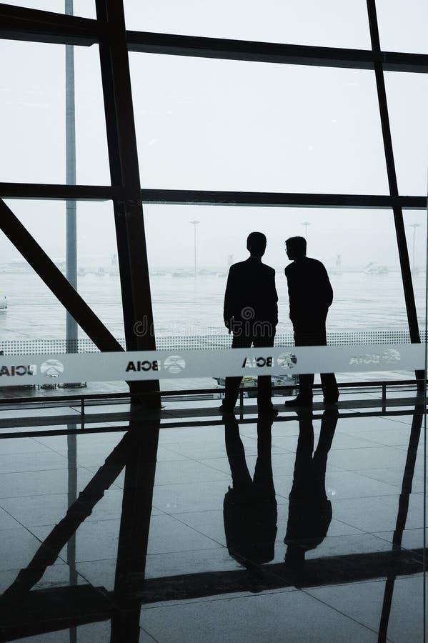 flygplatsbeijing personal två fotografering för bildbyråer