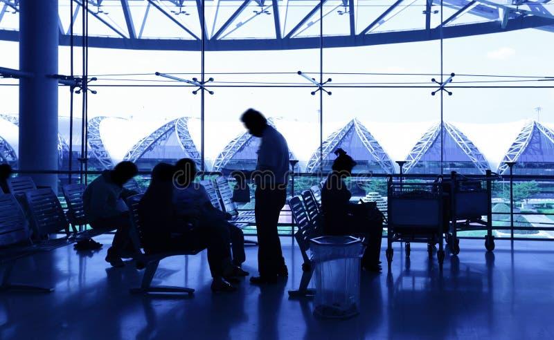 flygplatspassagerare royaltyfri foto