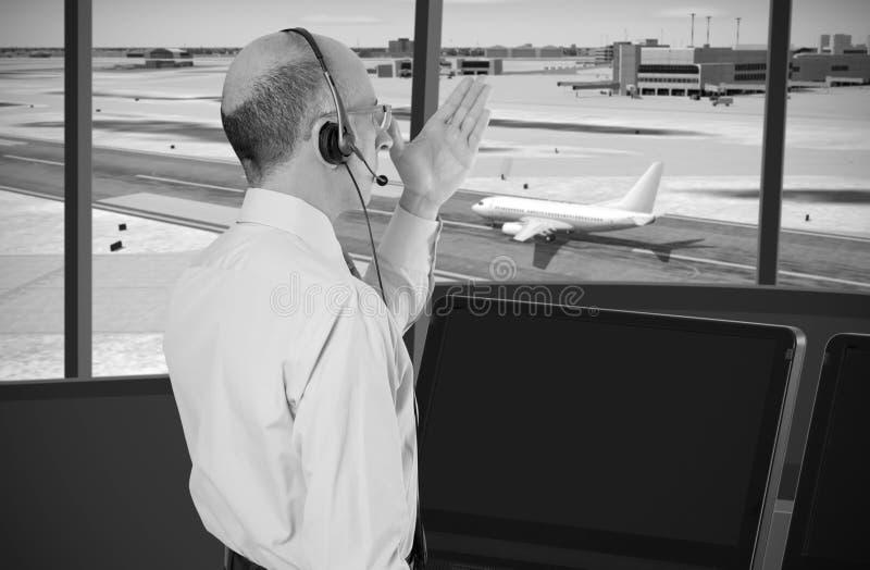 Flygtrafikkontrollant på arbete arkivbild