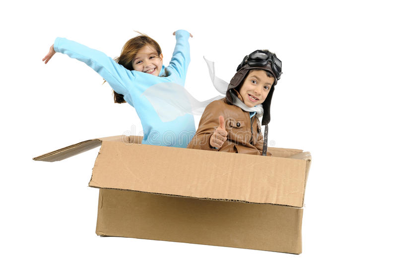 Flying. Youngcouple pilot flying a cardboard box isolated in white royalty free stock image