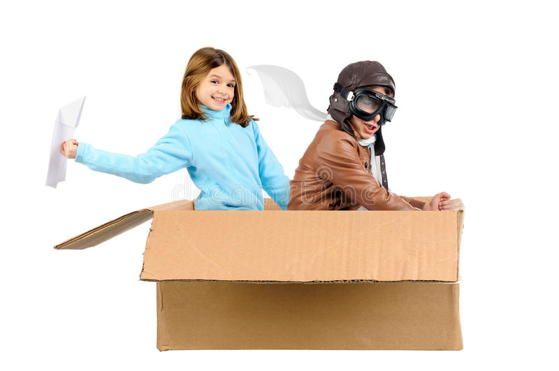 Flying. Youngcouple pilot flying a cardboard box isolated in white stock photos