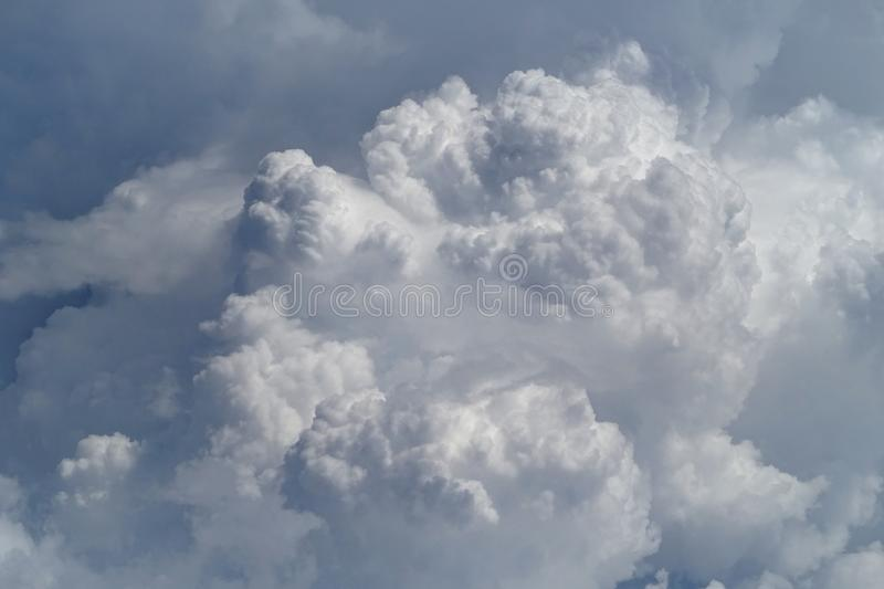 Flying above the clouds at 30,000 ft royalty free stock images