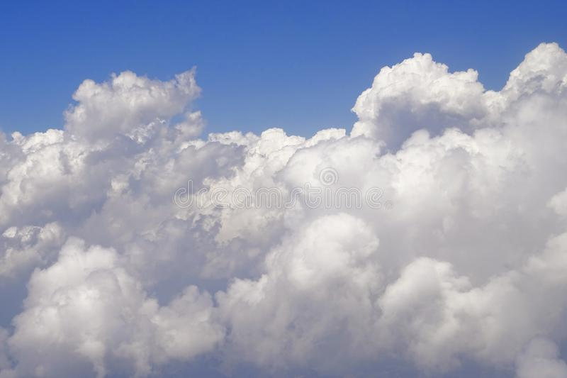 Flying above the clouds at 30,000 ft royalty free stock photography