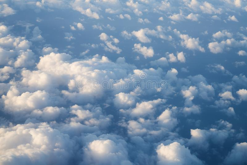 Flying above the clouds in midday. Skyscape royalty free stock photo