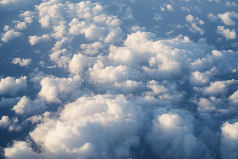Flying above the clouds in midday. Skyscape stock photos