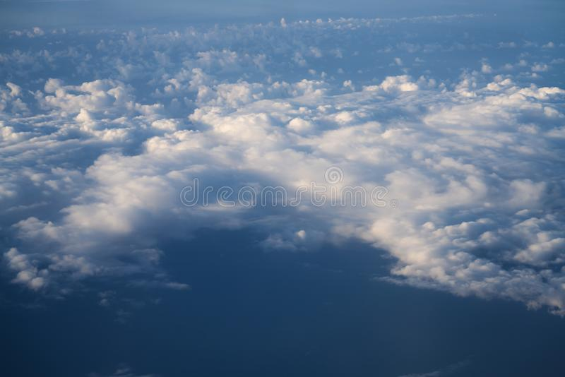 Flying above the clouds in midday. Skyscape stock images