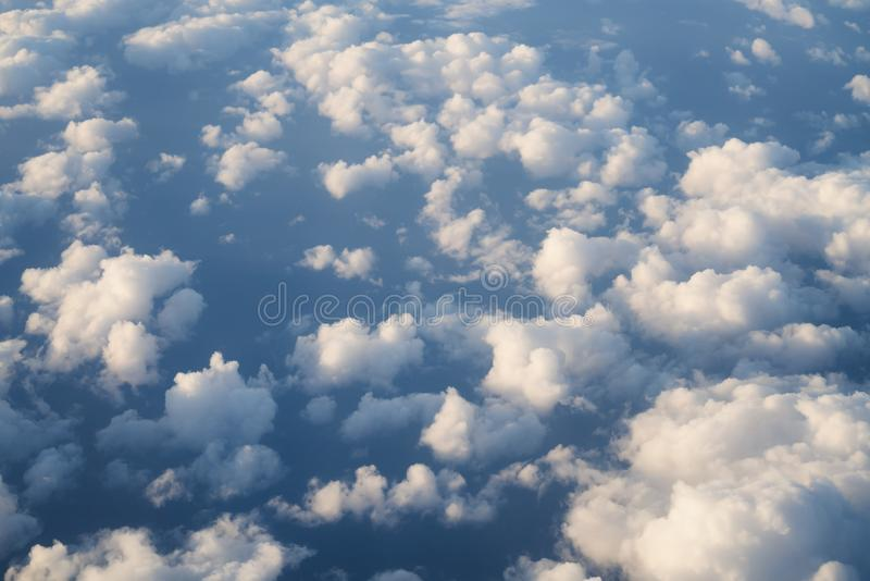 Flying above the clouds in midday. Skyscape royalty free stock photos