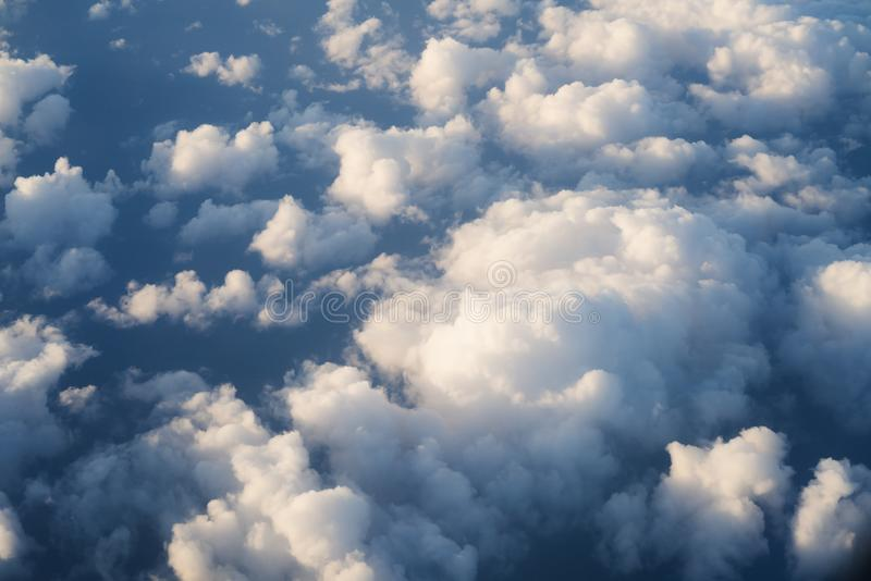 Flying above the clouds in midday. Skyscape royalty free stock photography