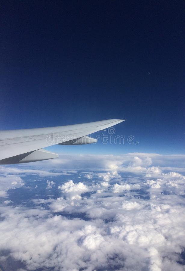 Flying above the clouds stock photography