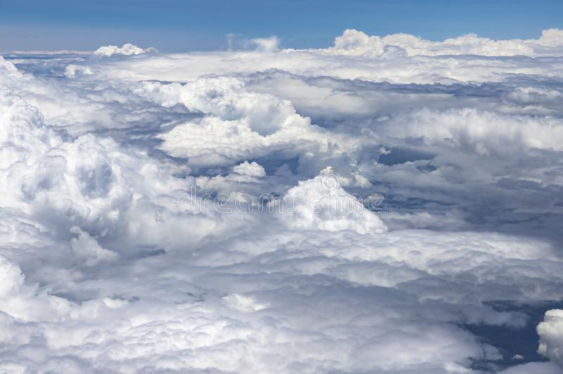 Flying above a dense layer of white clouds. Great and beautiful clouds. royalty free stock images