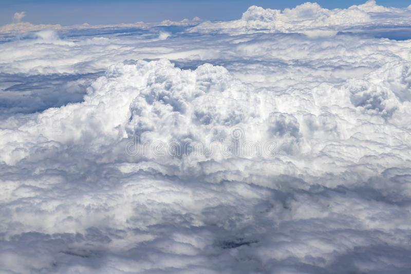 Flying above a dense layer of white clouds. Great and beautiful clouds. royalty free stock photography
