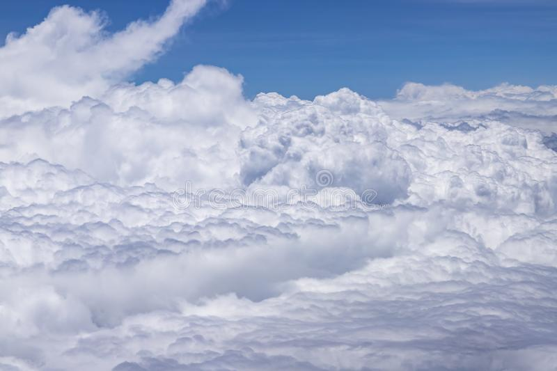 Flying above a dense layer of white clouds. Great and beautiful clouds. stock image