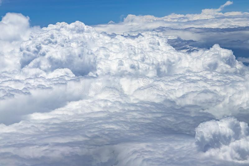 Flying above a dense layer of white clouds. Great and beautiful clouds. royalty free stock photos