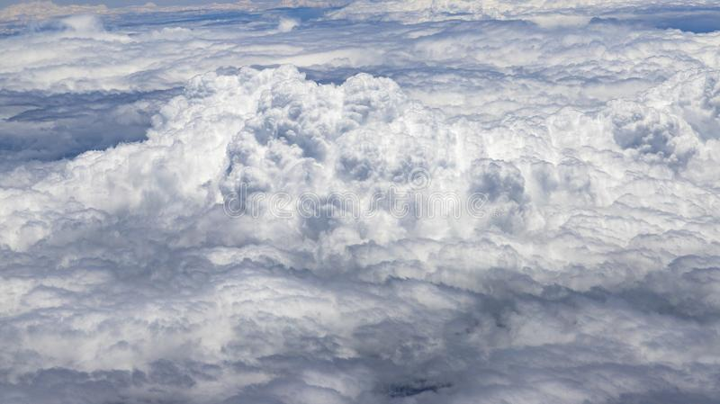 Flying above a dense layer of white clouds. Great and beautiful clouds. stock photo