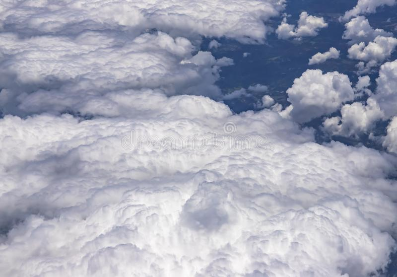 Flying above a dense layer of white clouds. Great and beautiful clouds. stock photography