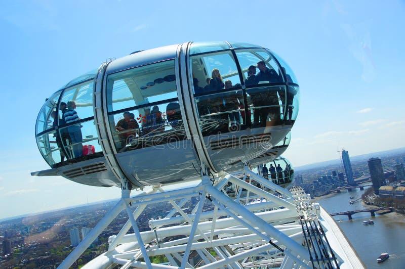 Flying above London. People in London Eye observing London