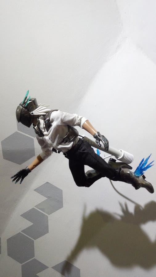 Flying action figure stock photo