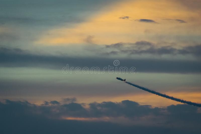 Flying Air Craft Under White Clouds At And Orange Sky At Sunset Free Public Domain Cc0 Image