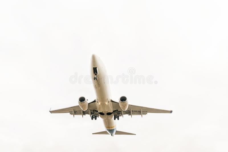 Flying aircraft, bottom view royalty free stock image