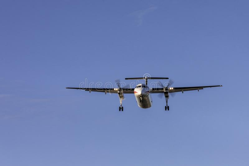 Flying aircraft preparing to land. At the airport stock images