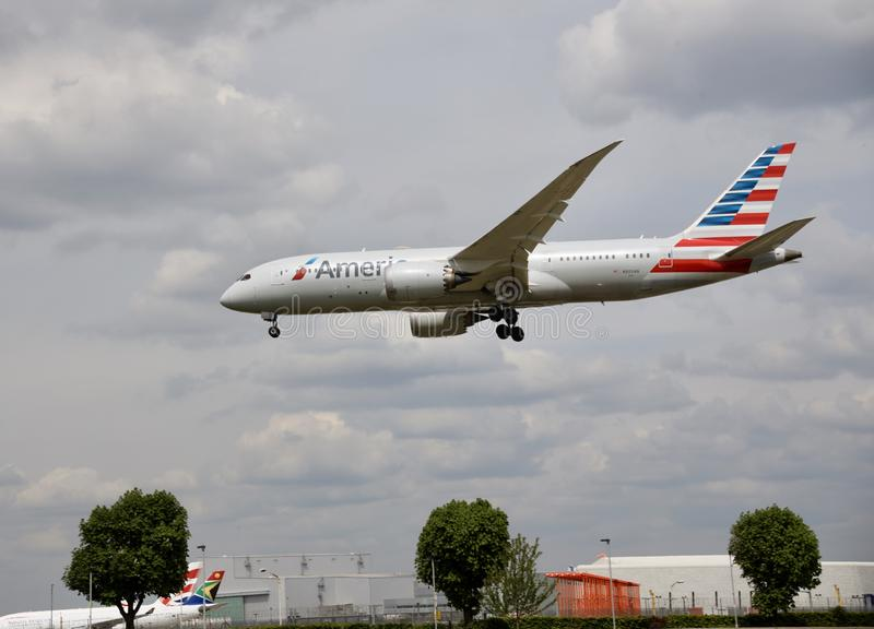 A flying airplane of American Airlines stock photography