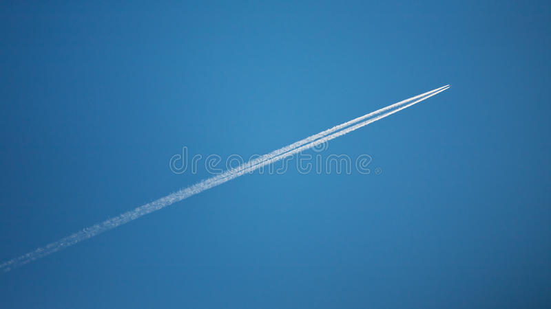 Download Flying Airplane With Contrails Stock Image - Image: 27750483