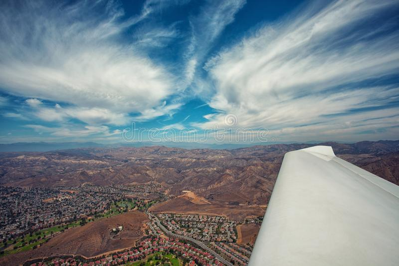Flying in an airplane over the gorgeous Californian landscape on a beautiful cloudy day. With a blue sky royalty free stock images
