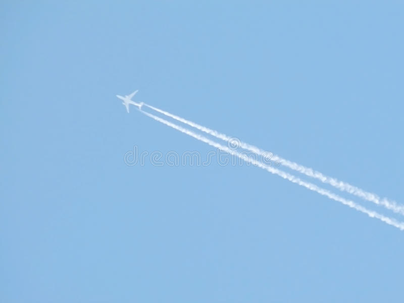 Flying an airplane in the sky royalty free stock image