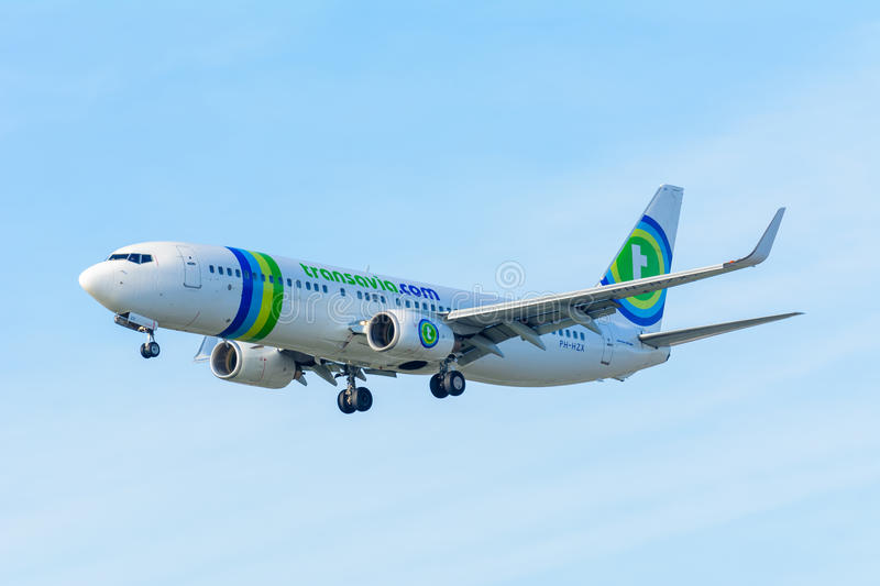 Flying Airplane Transavia PH-HZX Boeing 737-800 Transavia is landing at Schiphol airport. Schiphol, Noord-Holland/Netherlands - January 18-01-2016 - Flying stock image