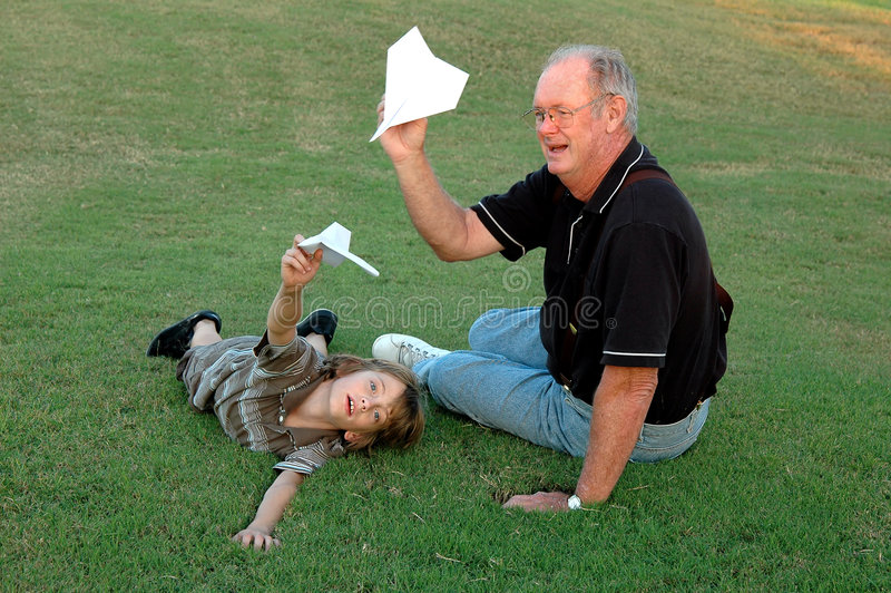 Flying airplanes with grandfather stock photography