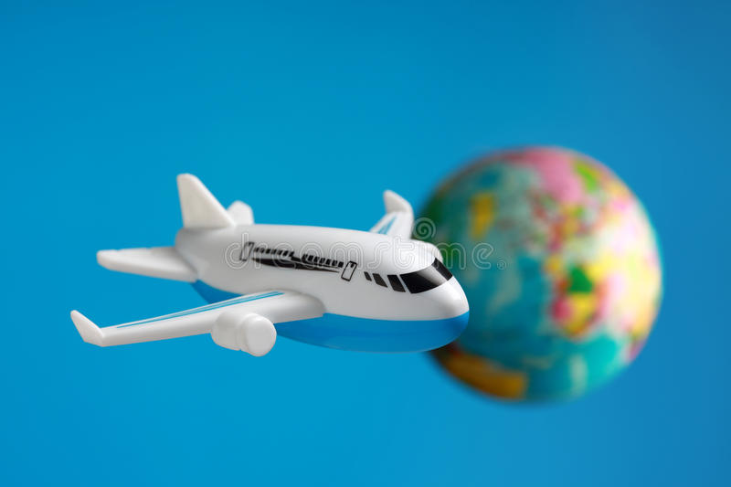 Flying around the world stock photography