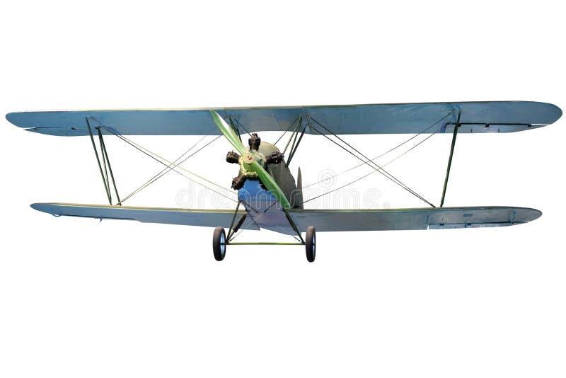 Flying biplane. Isolated on white stock photography