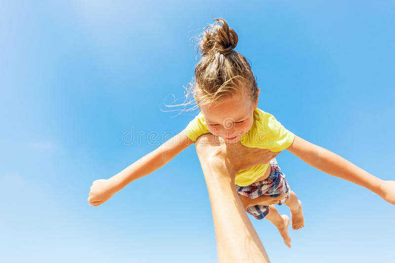 Flying boy like superman. On the blue sky background stock images