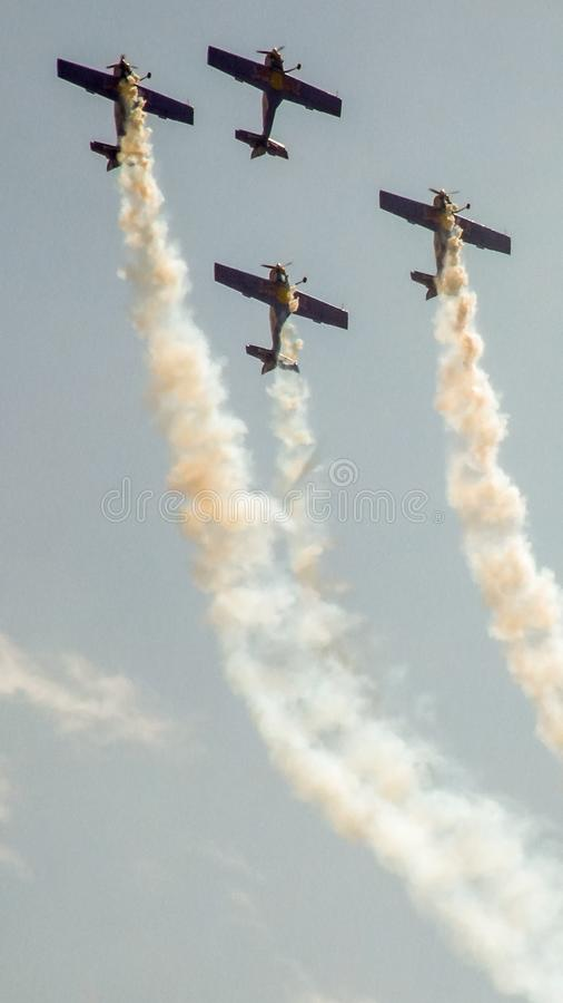 Four piston propeller aerobatic aicraft during display. stock photography