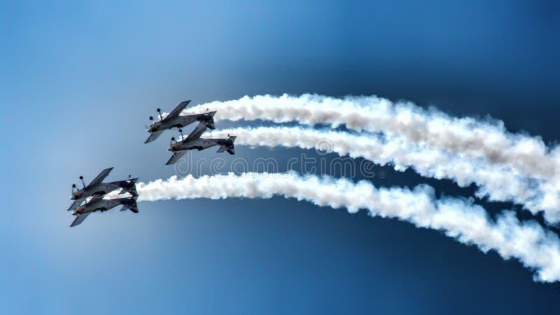 Four piston propeller aerobatic aicraft during display. stock image