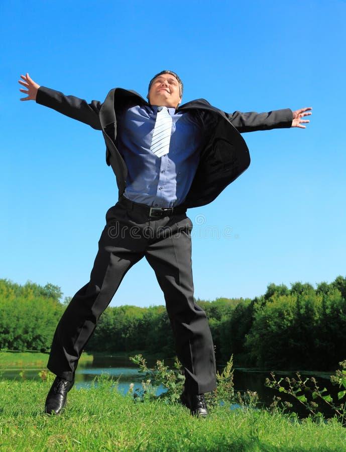 Flying businessman outdoor in summer full body