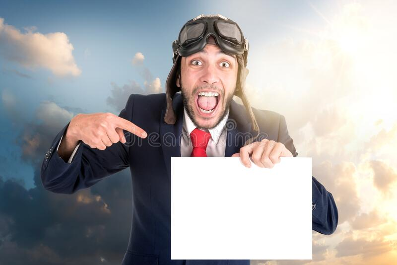 Flying businessman with blank paper stock photo
