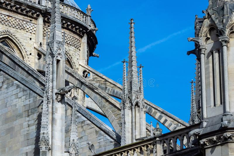 The flying buttresses on east facade of Notre Dame de Paris stock images