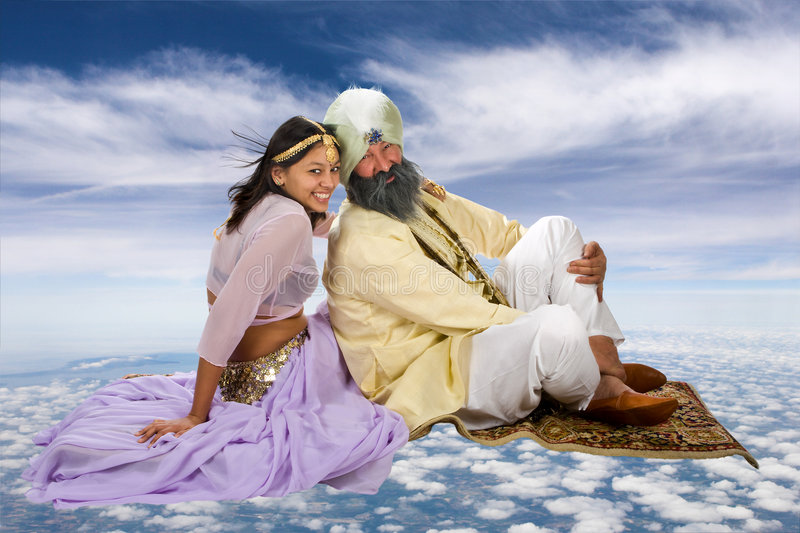 Flying carpet. Arabian story of Scheherazade and her Sultan on a flying carpet stock photography