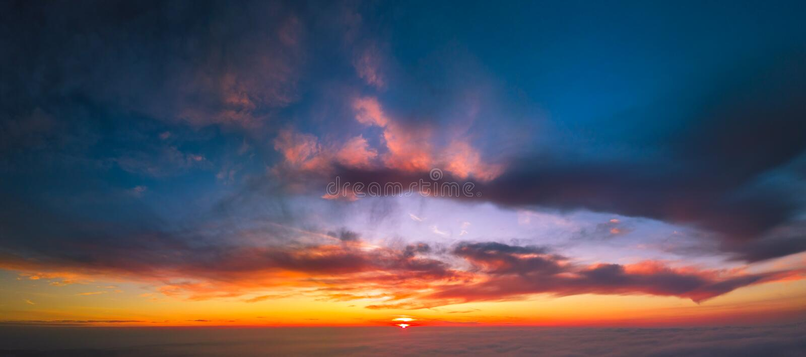 Flying between the cloud at sunset royalty free stock images