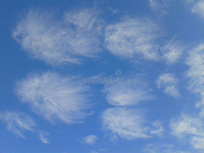 Flying clouds stock photo