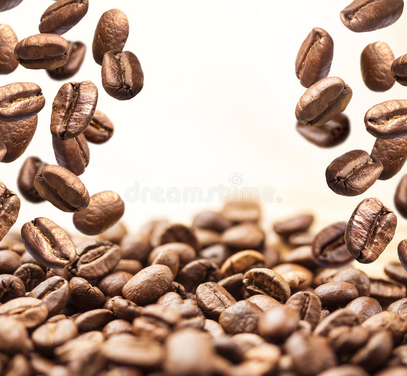 Flying coffee beans on white royalty free stock photo