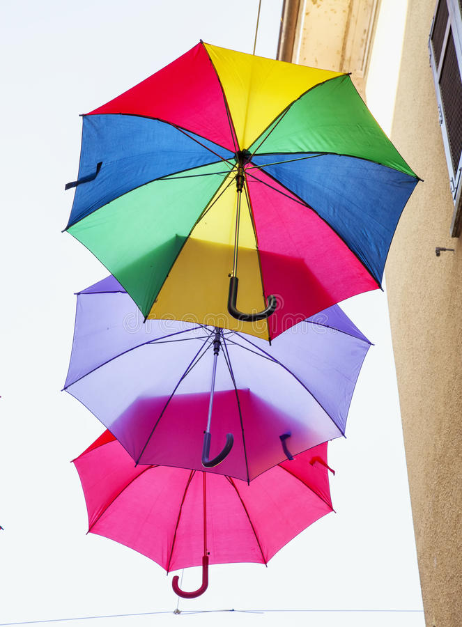 Flying colorful umbrellas. Colorful umbrellas flying in the sky, vertical image stock photography